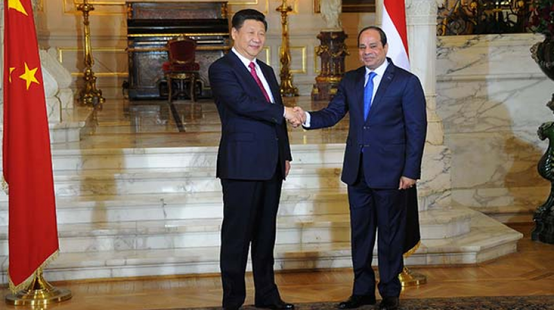 Chinese President Xi Jinping and Egypt's President Abdel Fattah al-Sisi shaking hands following a meeting in the Egyptian capital Cairo. (Photo: AFP)