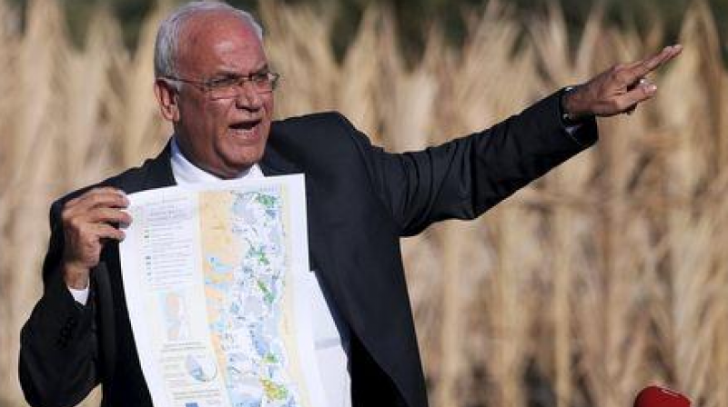 Palestinian Chief negotiator Saeb Erekat holds a map as he speaks to media about the Israeli plan to appropriate land, in Jordan Valley near the West Bank city of Jericho. (Photo: AFP)