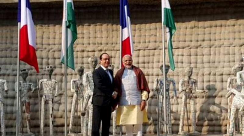 Prime Minister Narendra Modi with French President Francois Hollande in Chandigarh. (Photo: PTI)