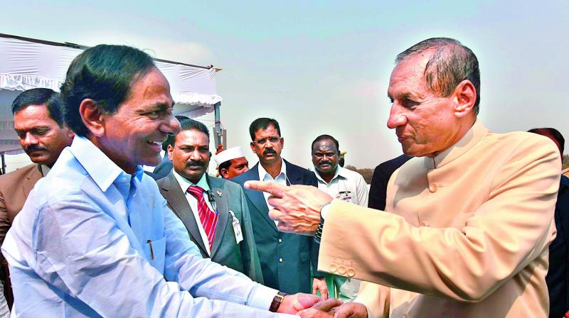 Governor E.S.L. Narasimhan is welcomed by Chief Minister K. Chandrasekhar Rao upon his arrival at the Parade Grounds for the Republic Day celebrations, in Secunderabad on Tuesday.