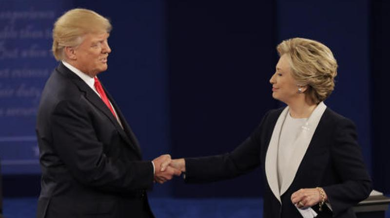 Republican presidential nominee Donald Trump shakes hands with Democratic presidential nominee Hillary Clinton following the second presidential debate at Washington University in St. Louis. (Photo: AP)