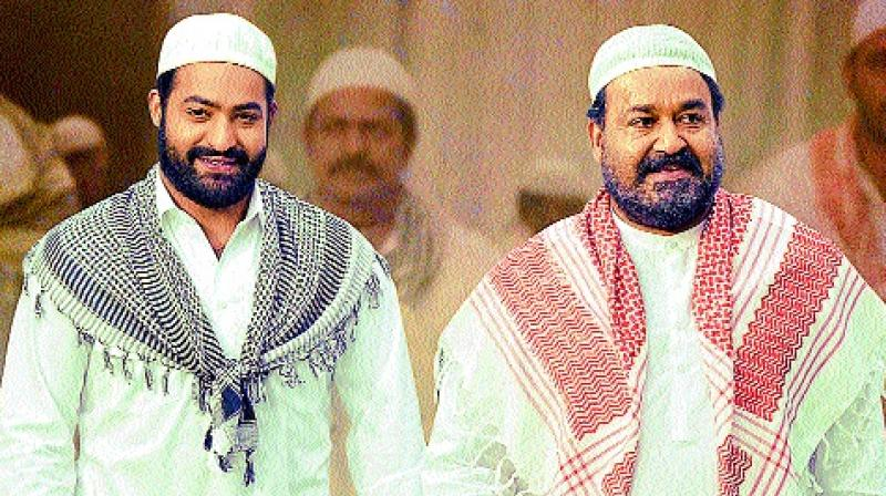 Jr NTR and Mohanlal in a still from the movie