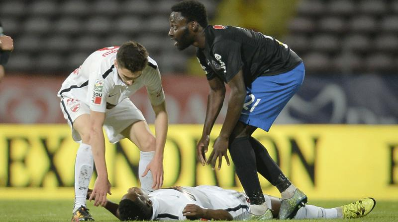 The 26-year-old midfielder fell to the ground without any contact with another player in the 70th minute of the game against Viitorul. (Photo: AP)