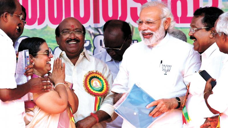 Prime Minister Narendra Modi gets them all togther at his public address in Kuttanad on Sunday. He is flanked by NDA's Kuttanad candidate Subash Vasu (extreme left), Preethy Natesan, SNDP Yogam president Vellapally Natesan, NDA Chenganur candidate P.S. Sreedharan Pillai and Mavellikara candidate P.S. Velayudhan at the NDA's election campaign in Alapuzzha. (Photo: ARUNCHANDRA BOSE)