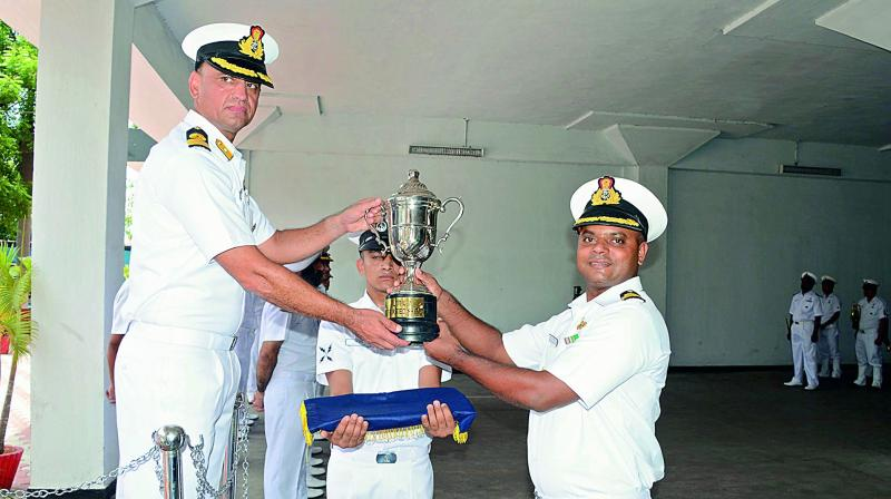 Naval officer-in-charge, Andhra Pradesh, Commodore Sanjeev Issar presents Most Spirited Ship of Local Flotilla award to commanding officer of INS Konkan during the Annual Flotilla Awards ceremony at Naval Dockyard in Visakhapatnam on Tuesday. (Photo: DC)