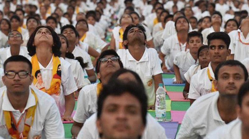 Yoga day programmes will also be organised in 391 universities, 16,000 colleges and 12,000 schools across the country. (Photo: PTI)