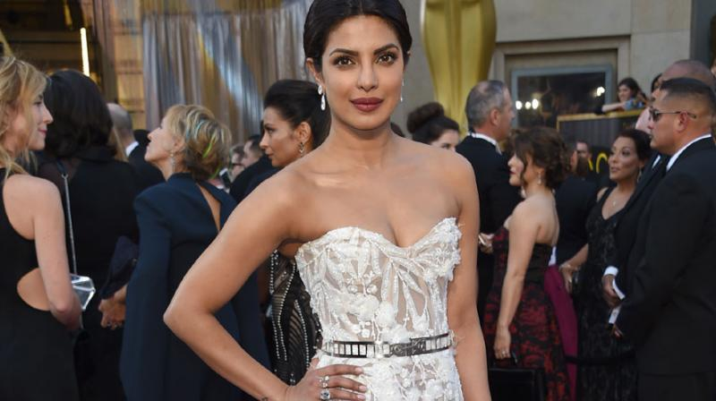 Bollywood actress Priyanka Chopra made her debut on the Oscars red carpet and did so like a pro. Photo: AP