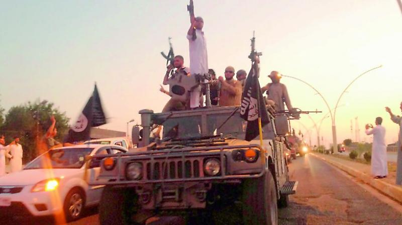 ISIS fighters showed off US manufactured M-16 rifles, crates of ammunition, mortars, a Toyota truck-all captured from American forces.