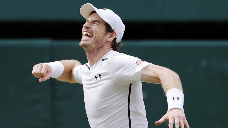 Andy Murray beat Milos Raonic 6-4, 7-6, 7-6 to win a second Wimbledon title and third Grand slam on Sunday. (Photo: AP)