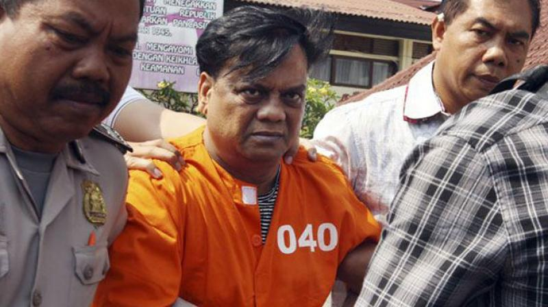 Chhota Rajan escorted by plain-clothed police officers for questioning in Bali, Indonesia. (Photo: PTI)