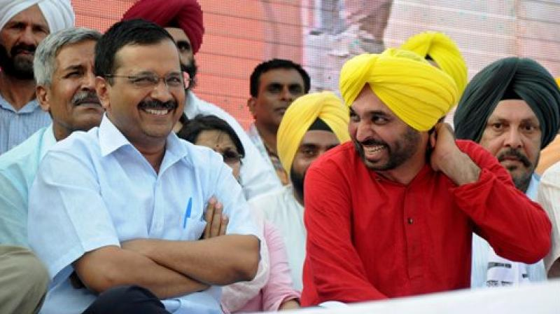 Delhi CM Arvind Kejriwal and AAP MP Bhagwant Mann during the releasing of 51-point Youth Manifesto in Amritsar on Sunday. (Photo: PTI)