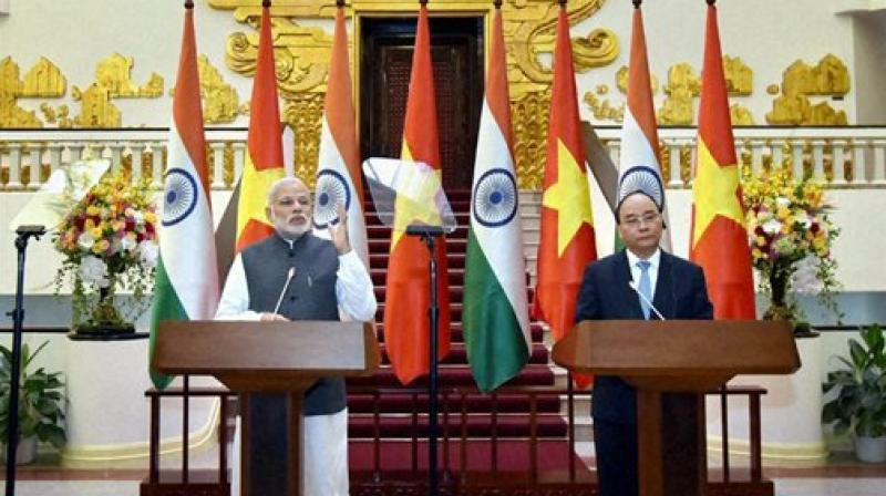 Prime Minister Narendra Modi with his Vietnamese counterpart Nguyen Xuan Phuc during a joint statement in Hanoi, Vietnam. (Photo: PTI)