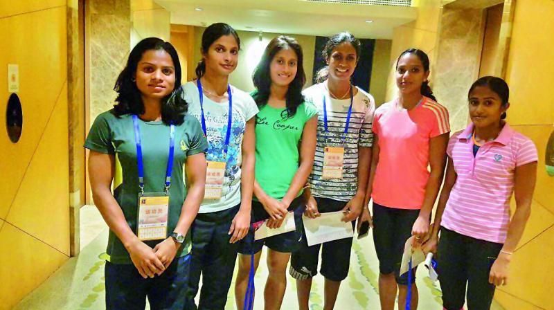 The Indian women's 4x100m relay team — Dutee Chand, Srabani Nanda, Hiriyur Manjunath, Merlin Kurian Joseph, Himashree Roy and Sini Sahadevan — pose in Beijing ahead of IAAF World Challenge, an Olympics qualifying event.