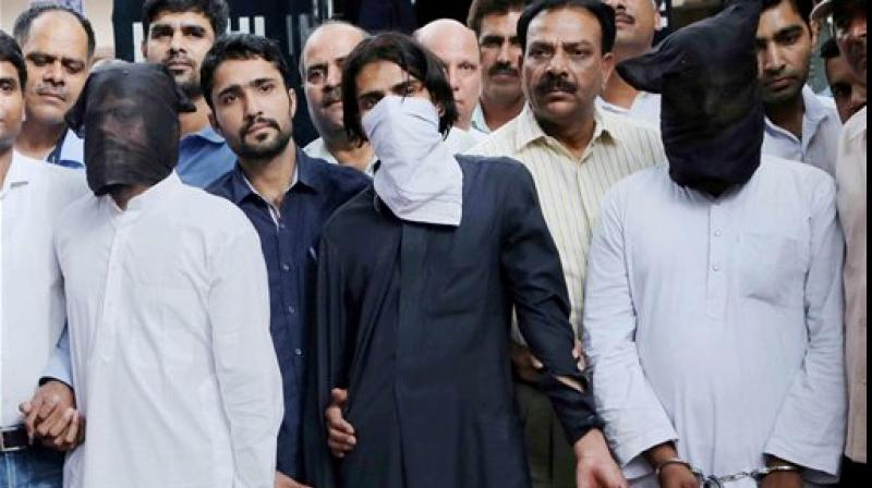 Mohsin (35), Zishan (19), Imran (23), residents of Chand Bagh and Muzahir (26), resident of Loni - returned home after being interrogated (Photo: PTI)