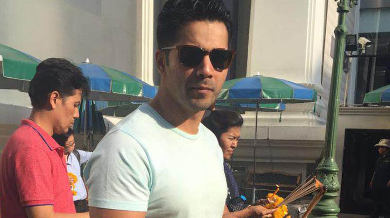 Actor Varun Dhawan, who is in Bangkok for an ad shoot, surprised a fan when he stopped to offer prayers to a deity in the middle of a street. Photo: Viral Bhayani
