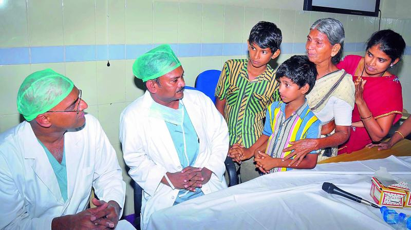 Yedukondalu's mother, wife and children thank cardiothoracic surgeon Dr Alla Gopala Krishna Gokhale who performed the heart transplant surgery at GGH on Friday. (Photo: DC)