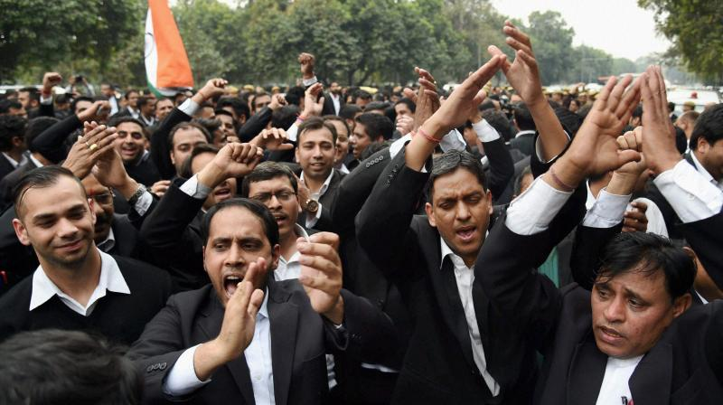 Lawyers raise slogans as they march from Patiala House Court to India Gate against alleged anti-national activities at JNU, in New Delhi. (Photo: PTI)