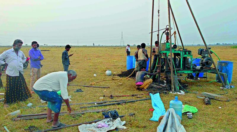 A team conducts soil test in the pooled land of Velgapudi village for the construction of AP temporary Secretariat. 	— DECCAN CHRONICLE