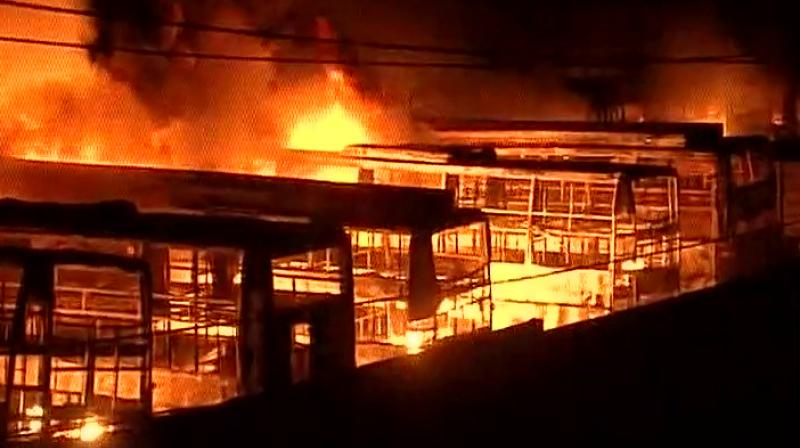 Angry mob reportedly set on fire a depot on Monday in Bengaluru amid the Cauvery water sharing row. (Photo: Twitter/ANI)