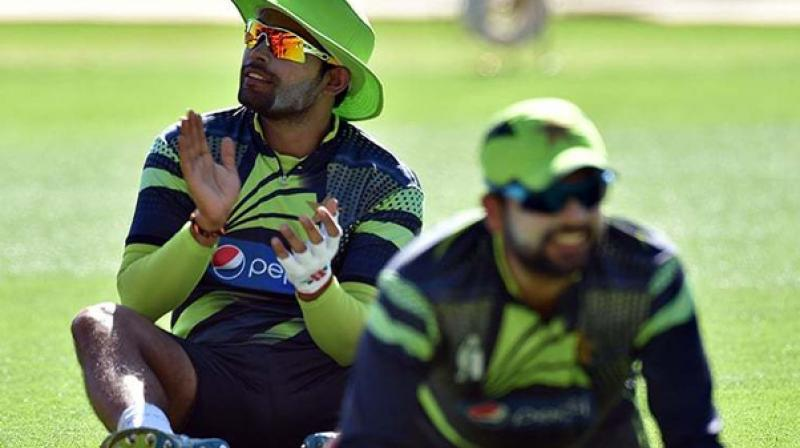 Pakistan opener Ahmed Shehzad and wicketkeeper-batsman Umar Akmal were on Monday dropped from the list of probables for the tour of England owing to their past indiscipline and poor recent form. (Photo: AFP)