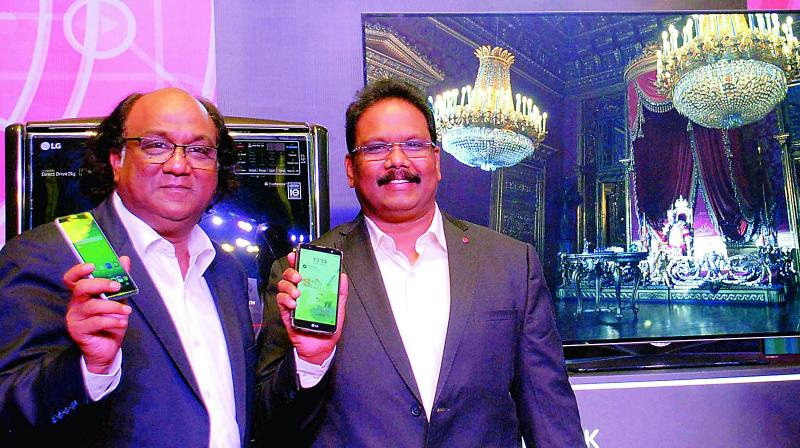 LG director-sales (south and west) Sanjeev Agarwal and Vijay Babu, business head, RAC, during LG India Tech Show 2016 in Hyderabad on Saturday (Photo: DC)