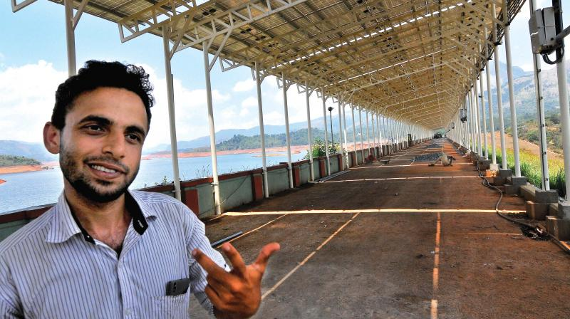 Keltron engineer K.T. Afeef, in front of the solar panel erected on the bund of Banasurasagar earthen dam in Padinharethara at Wayanad. Close to 1,760 solar panels, with each generating 230 watts have been installed. (Photo:  DC)