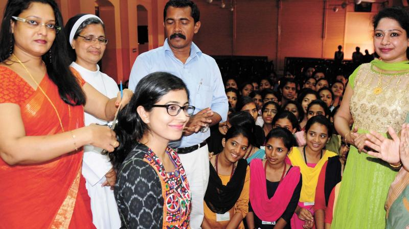 Actress Leona Lishoy at the hair donation camp St Mary's College, Thrissur (Photo: ANUP K VENU)