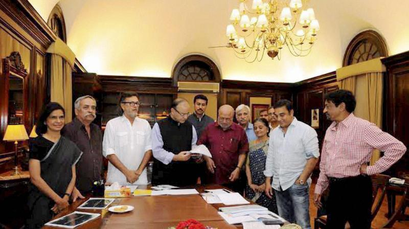 I & B Minister Arun Jaitley is presented the report on Cinematograph Act/ Rules from the members of Shyam Benegal Committee in New Delhi. (Photo: PTI)