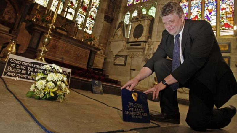 Head Verger Jon Ormrod tends to the grave of William Shakespeare in the Chancel of Holy Trinity Church in Stratford Upon Avon, England. (Photo: AP)