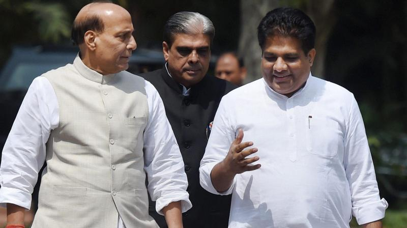 Union Home Minister Rajnath Singh with Minister of State Haribhai Parthibhai Chaudhary and Bhupender Yadav leaves after the BJP Parliamentary Board meeting in New Delhi. (Photo: PTI)