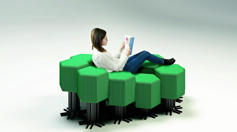 It is made up of upholstered hexagonal seats that can be used as stools or sofas.