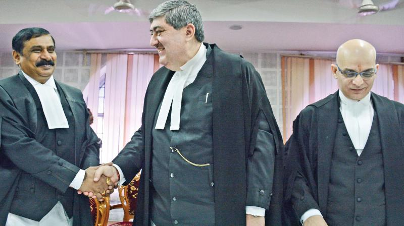 Chief Justice Sanjay Kishan Kaul greets Justice Huluvadi G Ramesh after the latter was sworn in as judge of the Madras High Court. Also seen is Justice Rajiv Shakdher, who was also sworn in as judge of the Madras high court on Monday, at a simple function held on the premises of the Madras HC. (Photo: DC)