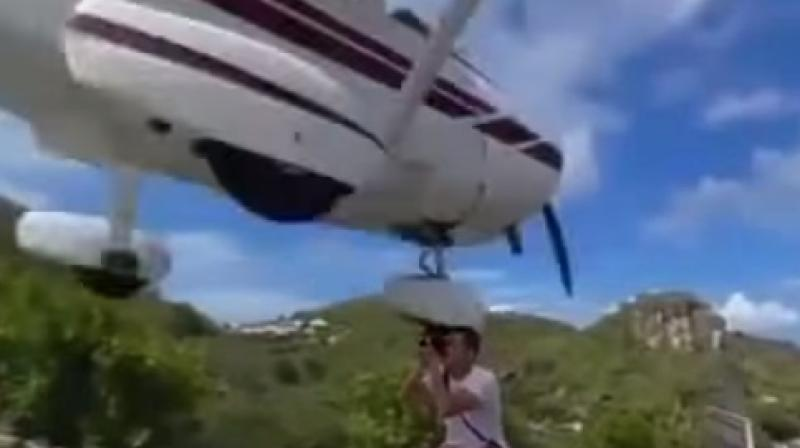 The plane which was about to land at St. Barts' Gustaf III airport, was a few inches away from the tourist's head. (Photo: Video grab)