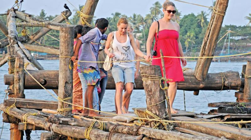 Foreign tourists at Fort Kochi (Photo: DC File pic)