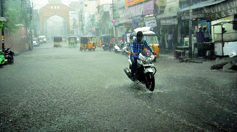 A biker braves the rain in Old City — (Photos by Mir Zulfequar Ali)
