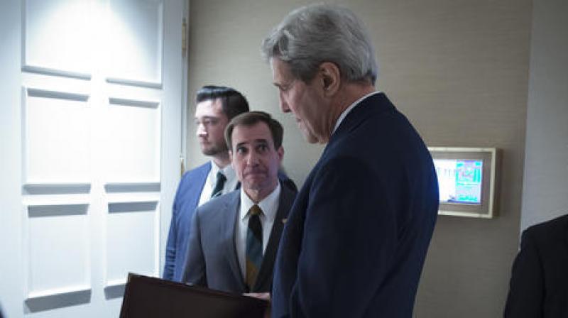 Secretary of State John Kerry, speaks to senior adviser John Kirby. (Photo: AP/File)