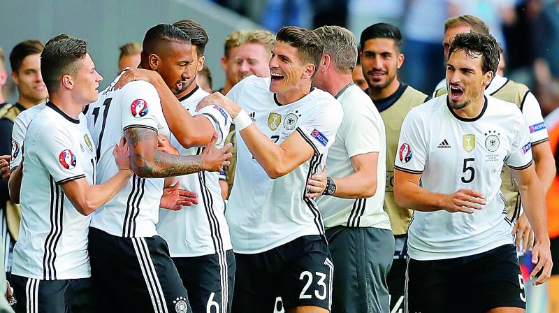 Germany's Jerome Boateng (second from left) celebrates with his teammates after scoring his side's first goal during the pre-quarterfinal against Slovakia at the Pierre Mauroy stadium in Villeneuve dAscq, near Lille on Sunday. (Photo: AP)