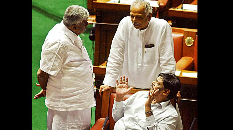Ministers Kagodu Thimmappa and H.C. Mahadevappa with JD(S) MLA H.D. Revanna in the Assembly  (Photo: KPN)