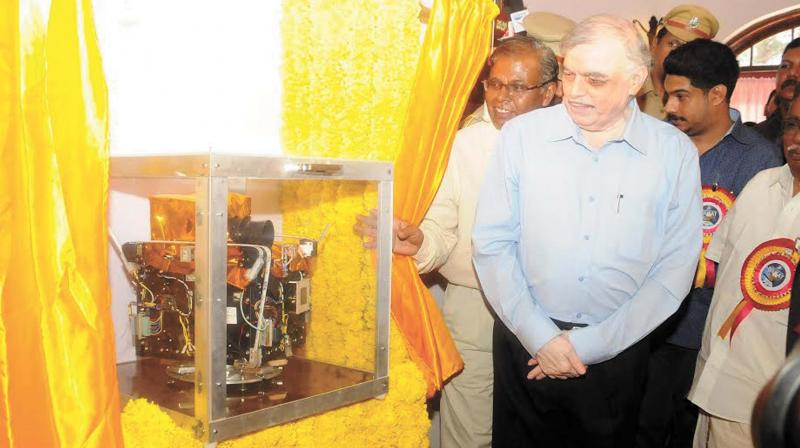 Governor P. Sathasivam during the Noorul Islam University ' NIUSAT' satellite handing over ceremony at Thiruvananthapuram on Saturday. This is the first private satellite to forewarn natural calamities. Noorul Islam University Pro-Chancellor M.S. Faizal Khan is also seen.  (Photo: A.V. MUZAFAR)