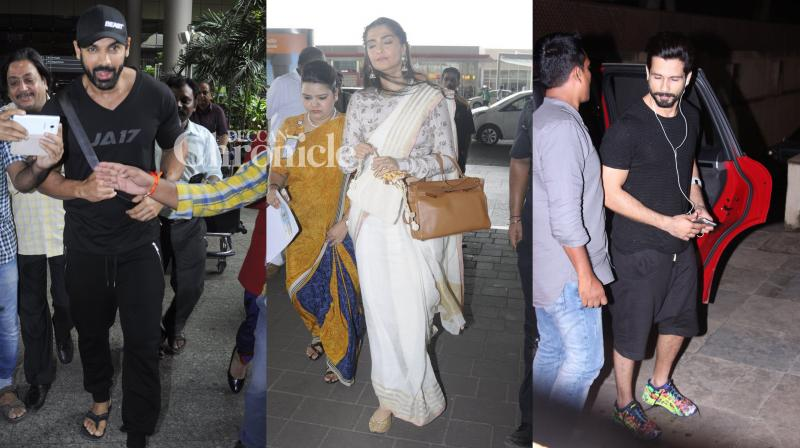 John Abraham and Shahid Kapoor had no qualms posing for the shutterbugs, while Sonam Kapoor seemed to be in a hurry. Kiran Rao, though, was her usual affable self. (Pic: Viral Bhayani)