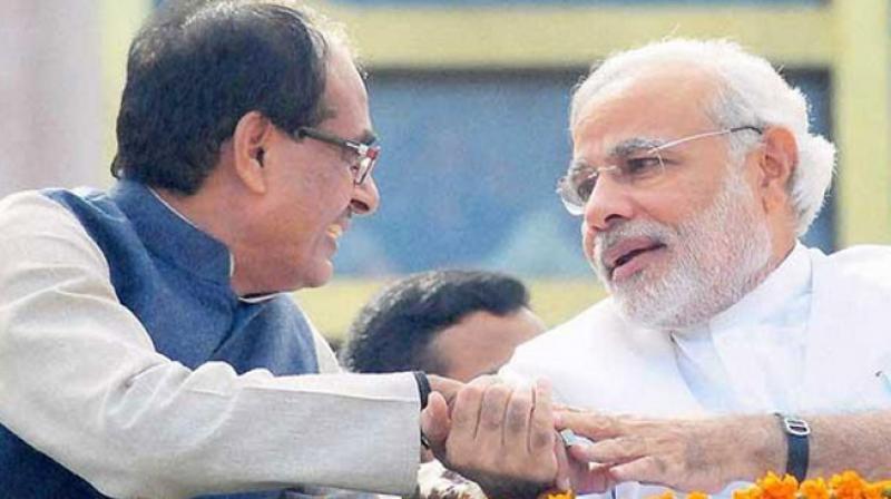 Madhya Pradesh Chief Minister Shivraj Singh Chouhan with Prime Minister Narendra Modi. (Photo: PTI)