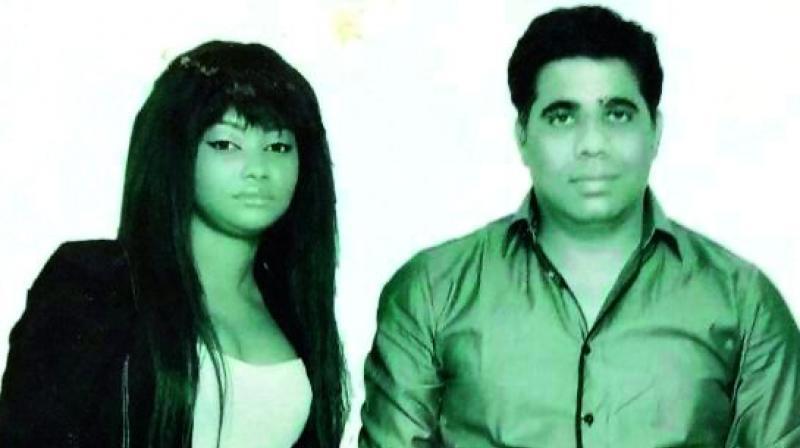 File image of Rupesh Kumar Mohnani and his wife, Cynthia.