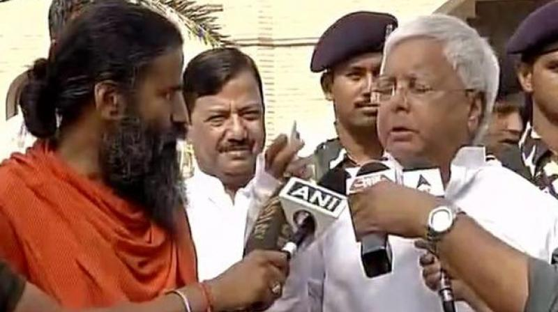 Ramdev, who is in Bihar since Tuesday for holding training camps in districts like Nalanda and Gaya, met the RJD chief at the residence of his wife Rabri Devi. (Photo: File)