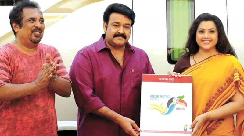Raveendran, Mohanlal and Meena at the logo release of Kochi Metro UAE Short Film Festival held in Kochi.