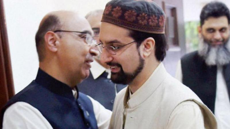 Pakistan High commision Abdul Basit greets Hurriyat Chairman Mirwaiz Umar Farooq durinng Eid Milan at Pakistan High Commision. (Photo: PTI)
