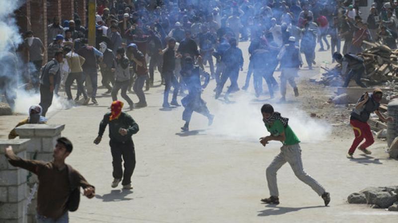 Two persons were injured as security forces fired teargas shells to chase away protesters. (Photo: PTI)