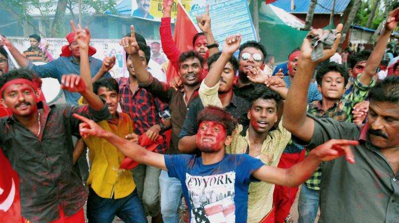 LDF workers celebrate the swearing-in of Pinarayi Vijayan as Kerala Chief Minister in Kozhikode. (Photo: PTI)