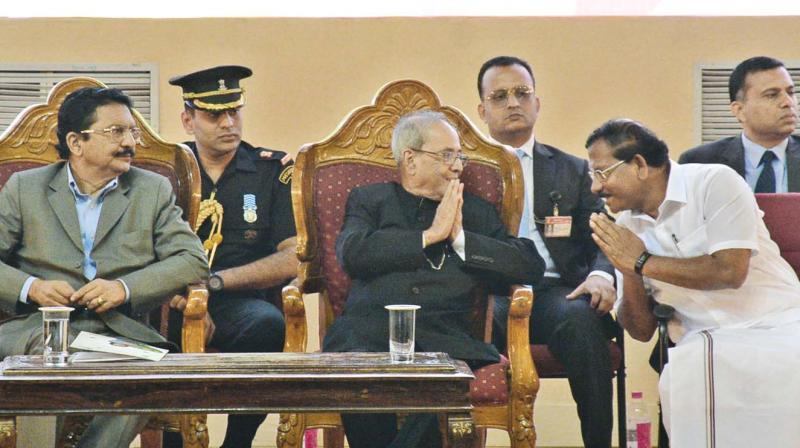 President Pranab Mukherjee with K. Pandiarajan, school education, sports and youth welfare minister of Tamil Nadu, during the centenary celebrations of Karur Vysya Bank. Governor of  Tamil Nadu, Vidyasagar Rao also seen. (Photo: DC)