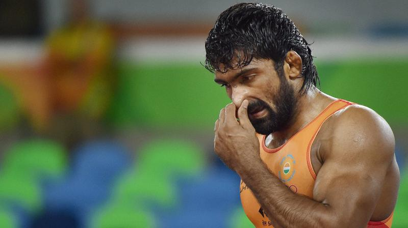 Expectations were high from Yogeshwar, a London Olympics bronze-medallist, but he looked a pale shadow of his previous gritty self in the 0-3 loss to Ganzorigiina Mandakhnaran of Mongolia, in the qualification round bout. (Photo: PTI)