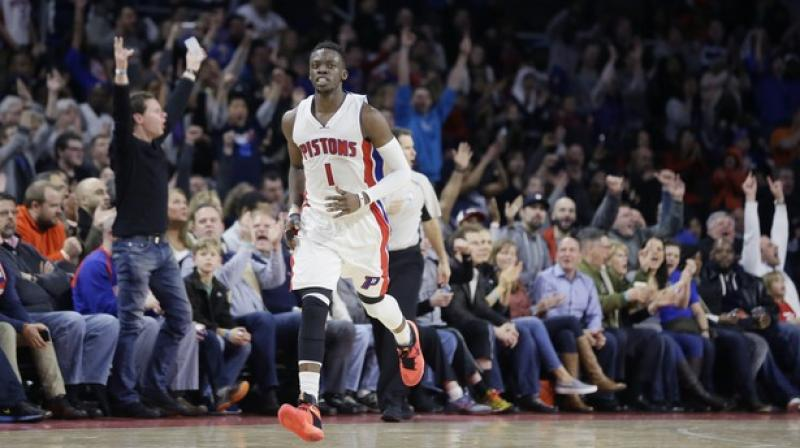Fans react after a 3-point basket by Detroit Pistons guard Reggie Jackson during the second half of an NBA basketball game against the Washington Wizards in Auburn Hills. (Photo: AP)